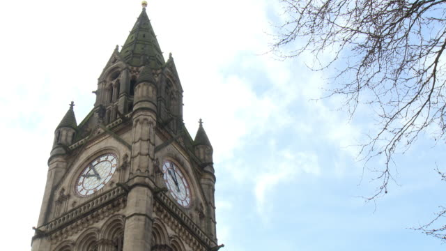 low-angle shot of manchester town hall clock, uk. - turmuhr stock-videos und b-roll-filmmaterial