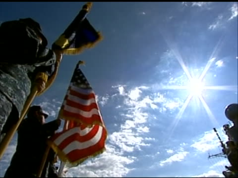 low-angle shot of soldiers holding flags at the arrival of leon panetta in tokyo. this footage took place during panetta's first official visit to... - (war or terrorism or election or government or illness or news event or speech or politics or politician or conflict or military or extreme weather or business or economy) and not usa点の映像素材/bロール