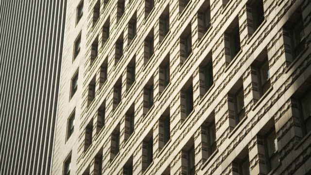 low-angle static view of contrasting lines and angles on chicago skyscrapers, illinois, usa. - 角度点の映像素材/bロール