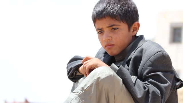 low-angle the face of a yemeni boy looking sad. - sadness stock videos & royalty-free footage