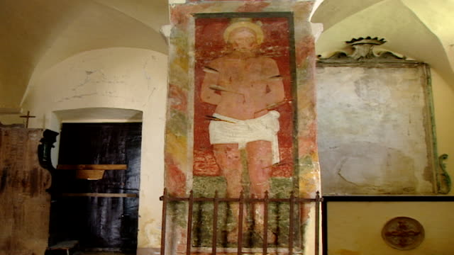 low-angle view of a medieval fresco of saint stephen at the church of saint maron in volperino. during the crusades the relics of saint maron,... - the crusades stock videos & royalty-free footage
