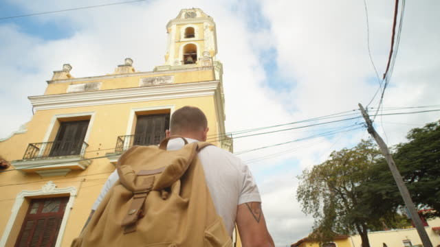 low-angle view of a traveler heading to a bell tower in trinidad, cuba - directly below stock videos & royalty-free footage