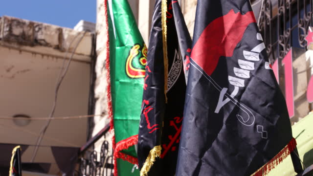 low-angle view of ashura themed flags in nabatieh. ashura is the 10th day of muharram commemorating the martyrdom of hussain ibn ali, the prophet... - ashura muharram stock videos & royalty-free footage