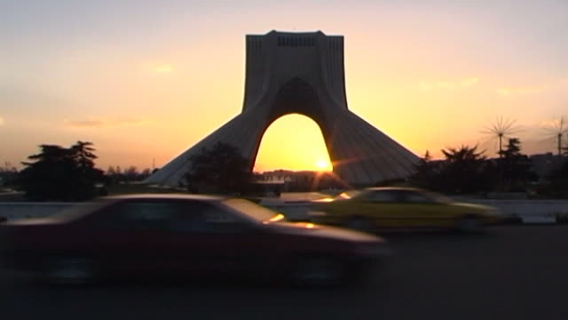 vidéos et rushes de low-angle view of azadi tower, a monument located on azadi square in tehran at sunset. - tour d'azadi
