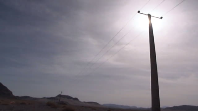 low-angle view of electricity poles on a desert road in yazd province. - yazd province stock videos & royalty-free footage