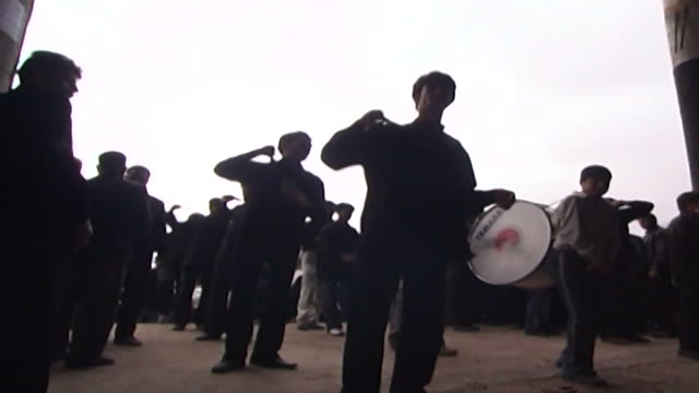 lowangle view of men performing azadari rituals during ashura at a mosque in isfahan province ashura the tenth day of the islamic month of muharram... - ashura muharram stock videos & royalty-free footage