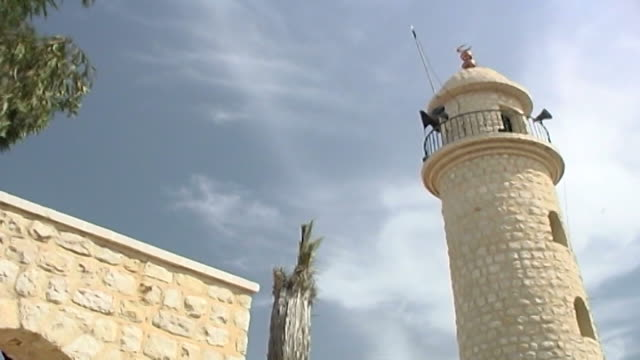 low-angle view of the mhaybi mosque loudspeaker attached to the minaret which can be used to call people in need of medical aid to the village square. - minaret stock videos & royalty-free footage