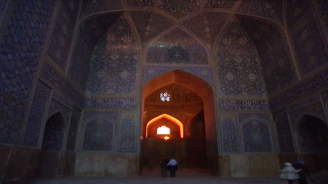 lowangle view of the safavid era ornamental blue and white tilework arches and recesses of the iwan leading to the lit main prayer hall of the shah... - shi'ite islam stock videos & royalty-free footage