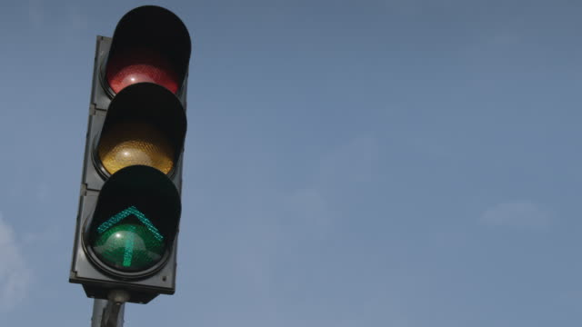 Low-angle view of traffic lights changing, India.