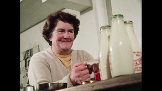 low-angle view of woman with milk bottles - glass material stock videos & royalty-free footage