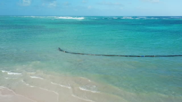 low-elevation: clear blue ocean in punta cana - punta cana stock videos and b-roll footage