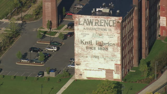 aerial lowell historic park and the lawrence manufacturing factory / lowell, massachusetts, united states - lowell stock videos & royalty-free footage