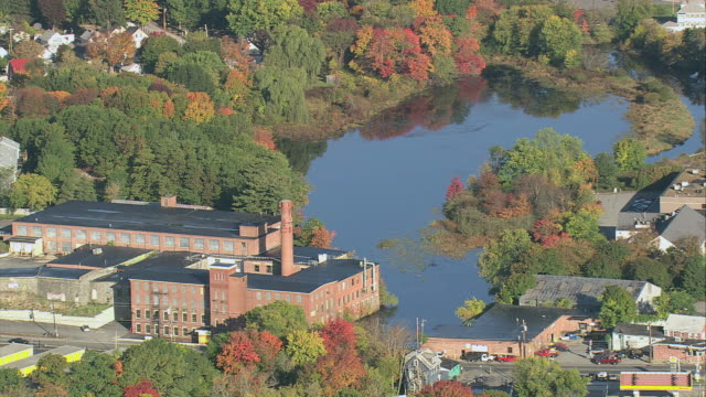 aerial lowell historic park, merrimack river, and fall foliage on riverbank / lowell, massachusetts, united states - industrial revolution stock videos & royalty-free footage