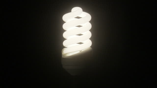 a low-energy bulb. - energy efficient lightbulb stock videos and b-roll footage