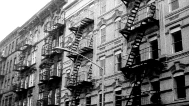 a lower east side tenement becomes a bright sparkling modern apartment complex in just fortyeight hours / demolition crews move in take out floors... - new york stato video stock e b–roll