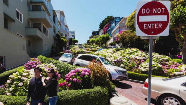 t/l lower end of lombard street in san francisco with cars winding down the road - stop sign stock videos & royalty-free footage