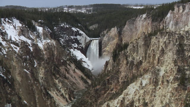 ws zi lower falls and valley at yellowstone national park / jackson, wyoming, usa - lower yellowstone falls stock videos & royalty-free footage