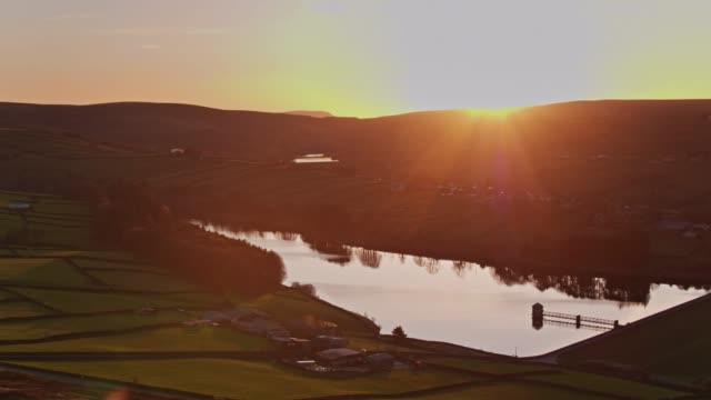 lower laiithe reservoir and stanbury, west yorkshire at sunset - drone shot - reservoir stock videos & royalty-free footage