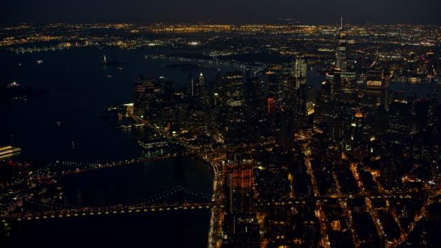 aerial lower manhattan and brooklyn bridge at night - new york city skyline stock videos & royalty-free footage