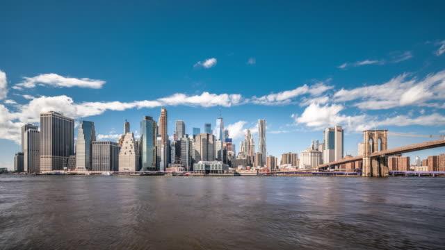t/l ws lower manhattan and brooklyn bridge / new york city, usa - new york city skyline stock videos & royalty-free footage