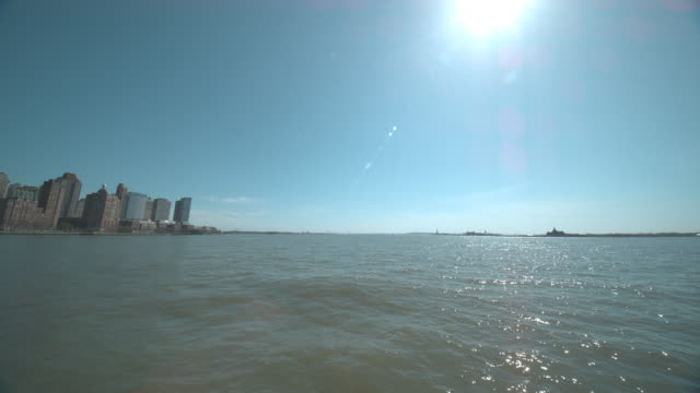 lower manhattan and statue of liberty from water - hudson river stock videos & royalty-free footage