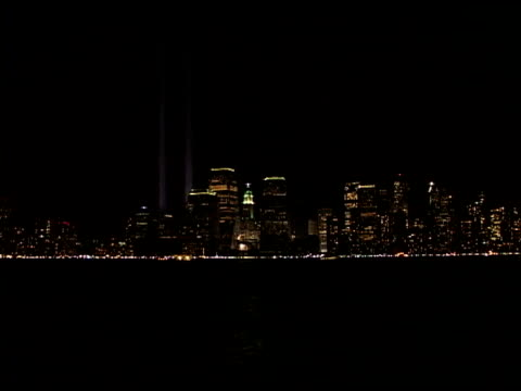 vs lower manhattan skyline at night w/ towers of light tribute shot from new jersey across hudson river march 2002 - september 11 2001 attacks stock videos & royalty-free footage