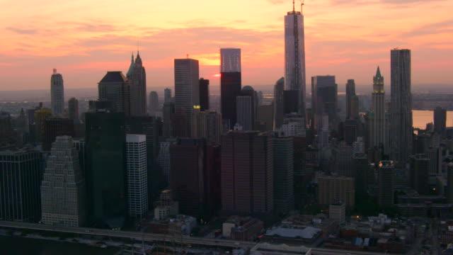aerial side pov lower manhattan skyline at sunset - deutsche bank stock videos & royalty-free footage