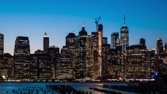t/l ws pan lower manhattan skyline day to night transition / new york city, usa - world trade center manhattan video stock e b–roll