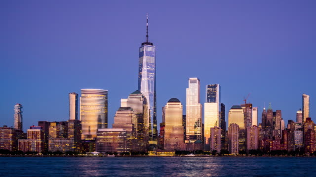 t/l zo lower manhattan skyline dusk to night transition / new york city, usa - world trade center manhattan video stock e b–roll