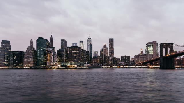 T/L Lower Manhattan skyline, from Dusk to Night / New York