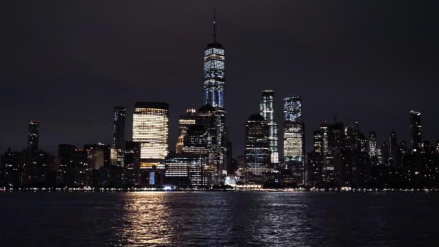 lower manhattan skyline, new york skyline at night - river east stock videos & royalty-free footage
