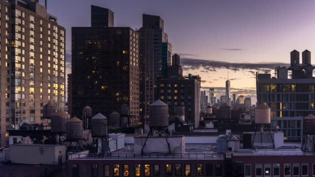 Lower Manhattan Skyline Over Midtown Buildings - Time Lapse