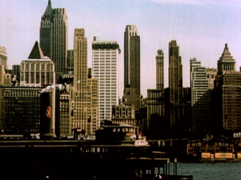 1960 POV Lower Manhattan skyscrapers viewed from Hudson River / New York City