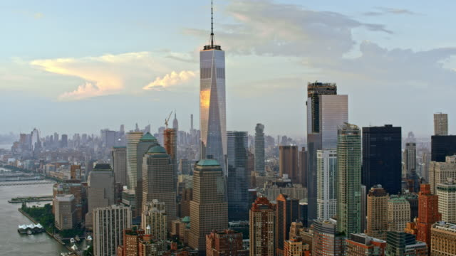 AERIAL Lower Manhattan with Freedom Tower reflecting the clouds