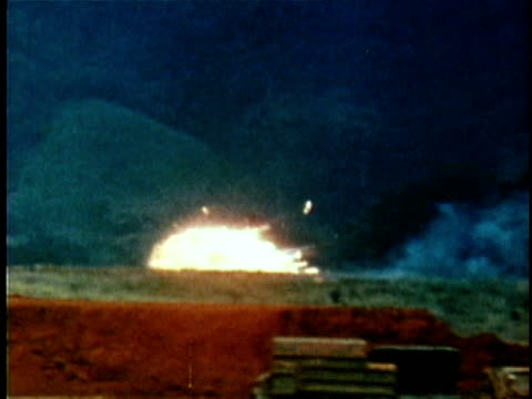 low-flying bomber plane dropping napalm bomb during the tet offensive / us air force airplanes on fire at air base / us soldier being carried on... - 1968 stock videos & royalty-free footage