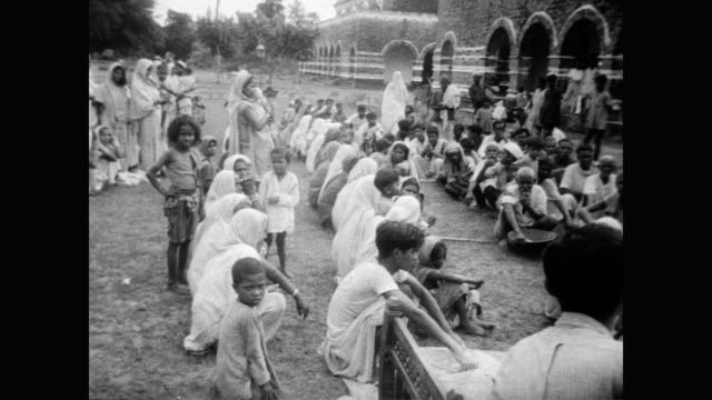 / lowlands of india devastated by torrential rain / houses destroyed or underwater / crops destroyed / refugees awaiting relief sit around despondent... - 1956 stock videos and b-roll footage