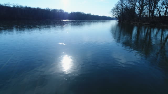 low-level aerial of the potomac river in the morning - river potomac stock videos & royalty-free footage