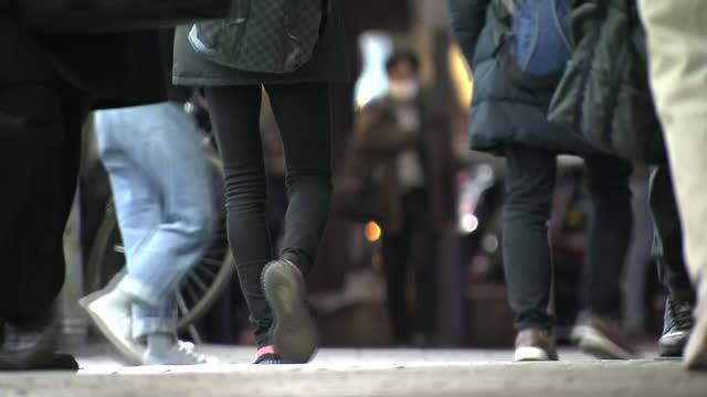 low-position, people walking downtown tokyo, japan - walkable city stock videos & royalty-free footage