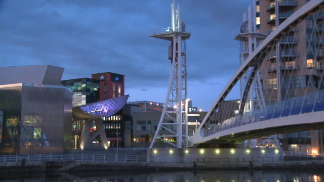 zo, ms, lowry centre and millennium bridge at dusk, salford quays, manchester, england - salford quays stock videos & royalty-free footage