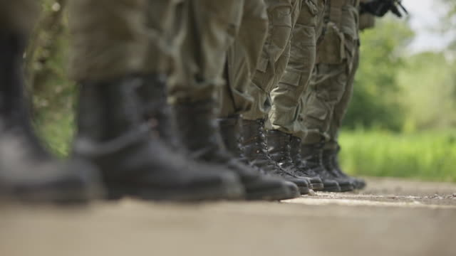 low-section of military soldiers standing in line 4k stock video - authority stock videos & royalty-free footage