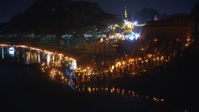 Loy Krathong with coconut shell or Yi Peng Day is one of the most popular festivals fair world heritage of lamphun, Thailand