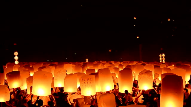 loy kratong festival and lantern lift off - lantern stock videos & royalty-free footage