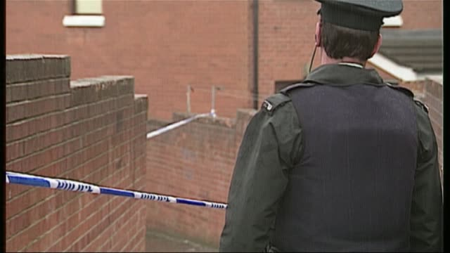 Loyalist 'supergrass' has jail term slashed DATES Police officer standing in front of cordon tape in alleyway ZOOM IN PULL FOCUS Police cordon tape...