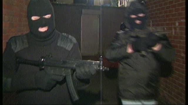 Loyalist 'supergrass' has jail term slashed DATES UNKNOWN Men wearing balaclavas along with sub machine guns UVF Paramilitary members at entrance to...