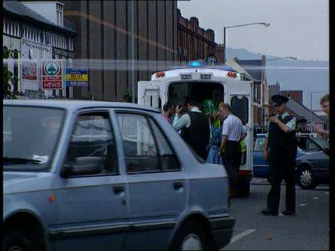 Loyalist terrorists murdered N IRELAND Loyalist terrorists murdered N Belfast Ormeau Rd LMS Police behind cordon at scene of murder of Loyalists Joe...