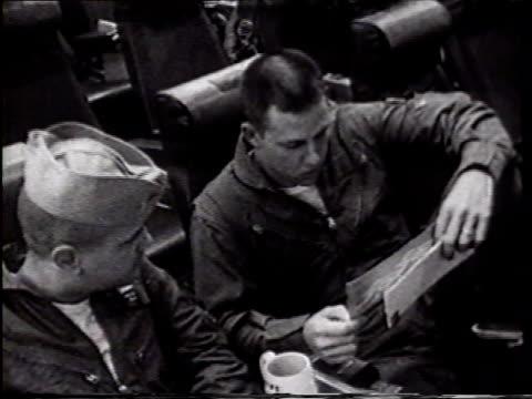 stockvideo's en b-roll-footage met lt. charlie baldock listening to unidentified pilot sot reading letter from lady in pennsylvania. front carrier deck w/ parked a-4 'skyhawk' jets,... - pilot