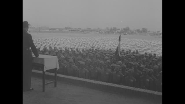 lt gen albert wedemeyer and chiang kaishek look over vast number of chinese soldiers during world war ii troop review / note exact month/day not known - chiang kai shek stock-videos und b-roll-filmmaterial