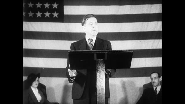 lt governor sheridan downey standing at podium w/ american flag bg explaining each will get money seniors seated listening seniors asking questions... - 1935 stock-videos und b-roll-filmmaterial
