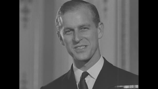 lt philip mountbatten poses for photos in buckingham palace for the last time before his upcoming wedding to princess elizabeth / note exact day not... - prince philip stock videos & royalty-free footage