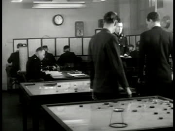 lt. roberts' and 'inspector finch' looking at table map english policemen radiomen. policeman looking at map through table magnifying glass. making... - 1949 stock videos & royalty-free footage